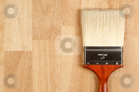 Paint Brush on Wood Surface stock photo, Paint Brush on a Wood Surface with Copy Room. by Andy Dean
