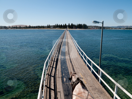 Old pier at Granite Island and Victor Harbor stock photo, Wooden pier and railway track at Granite Island and Victor Harbor near Adelaide in Australia by Steven Heap