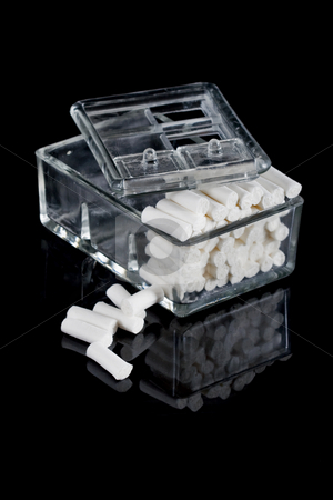 Stomatology equipment stock photo, Stomatology equipment, round white cotton bars by Nikola Spasenoski