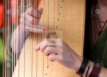 Harp stock photo, Close-up of someone by Henrik Lehnerer