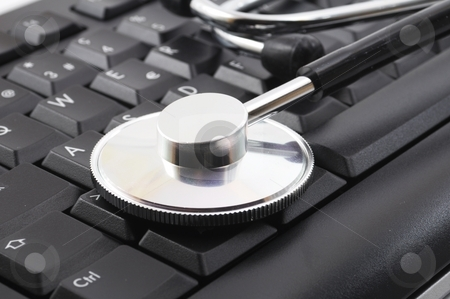 Stethoscope on computer keyboard stock photo, Stethoscope on computer keyboard showing medical or pc support concept by Gunnar Pippel