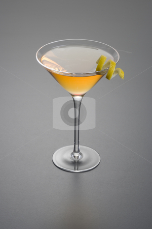Dry Rob Roy or Manhattan cocktail stock photo, Manhattan cocktail with lemon peel garnish close up on grey background by Gabe Palmer