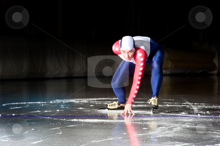 Speed skating start stock photo, Speed skater at the starting line on an indoor ice rink by Corepics VOF