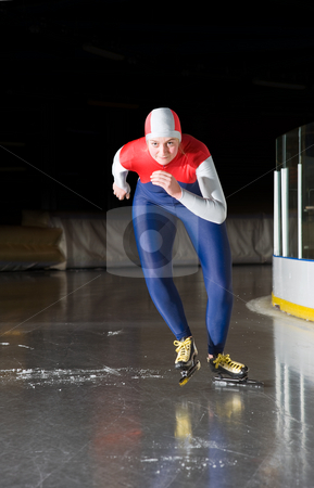 Speed skating start stock photo, Speed skater departing for her race on an indoors ice rink by Corepics VOF