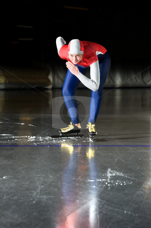 Speed skater at the starting line stock photo, Speed skater at the starting line of a long distance race in an indoor ice rink by Corepics VOF