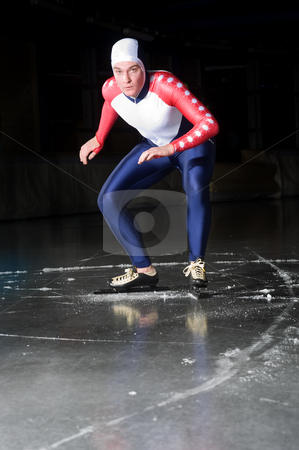 Speed skating start stock photo, Speed skater at the starting line of a long distance race on an indoor ice rink by Corepics VOF