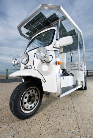 Solar powered tuc tuc stock photo, Solar powered tuc tuc on the boulevard near the beach by Corepics VOF