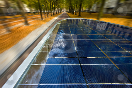 Solar powered tuc tuc stock photo, Solar powered tuc tuc driving through a street at high speed by Corepics VOF