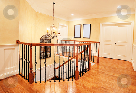 Upper Hallway and Staircase in Upscale Home stock photo, Interior of an upscale home, showing the upper hallway and top of the staircase. Horizontal format. by Christopher Nuzzaco