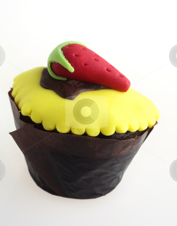 Cupcake with strawberry stock photo, A spectacular cupcake with a strawberry on top, ideal kiddy party food by Paul Cowan