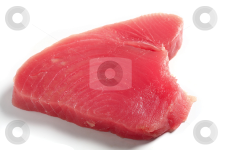 Tuna fish steak stock photo, Bluefin tuna (blue ahi tuna) steak, over white. This is regarded as the finest tuna and is the kind used in sushi. by Paul Cowan