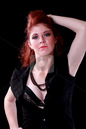 Young redhead woman with shirt open showing bra stock photo, Pretty caucasian redhead woman black shirt and bra by Jeff Cleveland