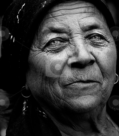 Dark artistic portrait of expressive senior woman stock photo, Dark artistic portrait of expressive senior lady by Dunca Daniel