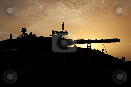 Tank silhouette at sunset stock photo, Israeli - Palestinian conflict. Israeli military operation Cast Lead. Israeli tank Merkava ( Mercava)  Mk 4 on border with Gaza strip by Dmitry Pistrov