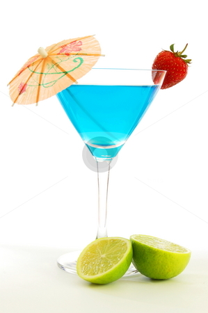 Cocktail stock photo, Blue martini cocktail with strawberry and umbrella by Gunnar Pippel