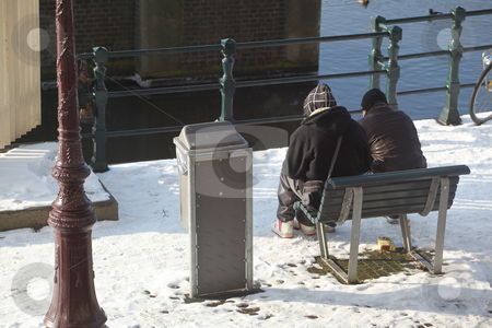 Amsterdam stock photo, Couple in amsterdam in the winter time. by OSCAR Williams