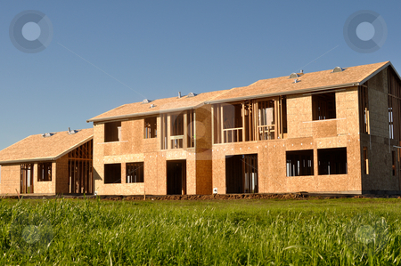 Home Construction stock photo, Three Homes under construction in rural area by Brandon Bourdages