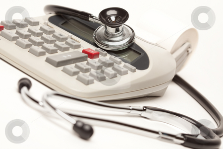 Black Stethoscope on Calculator stock photo, Black Stethoscope on a Calculator with Selective Focus. by Andy Dean