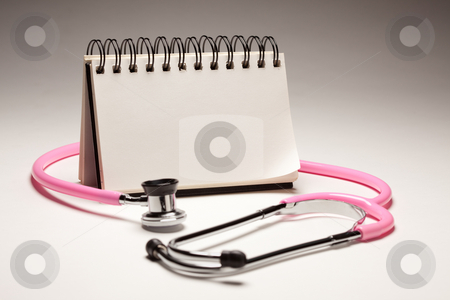 Blank Spiral Note Pad and Pink Pediatric Stethoscope stock photo, Blank Spiral Note Pad and Pink Pediatric Stethoscope on Gradated Background. by Andy Dean