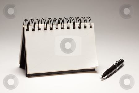 Blank Spiral Note Pad and Pen stock photo, Blank Spiral Note Pad and Pen on a Gradated Background. by Andy Dean