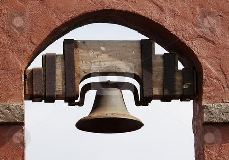 Bell stock photo, Old Spanish style bell hanging in a red brick wall by Henrik Lehnerer