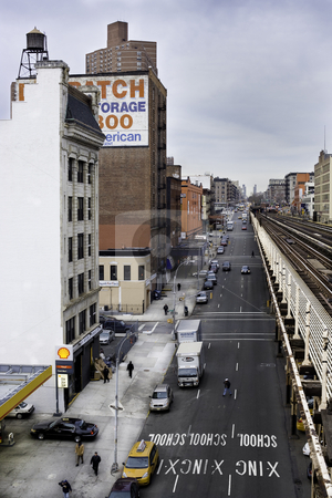 Harlem stock photo, Street view from the 125th st station in Harlem, NY. by Felice Fornabaio