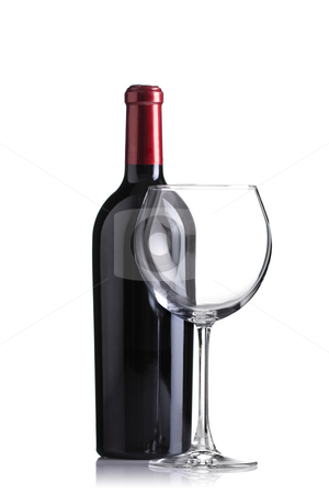 Red wine bottle and an empty glass stock photo, Isolated red wine bottle and an empty glass, focus on glass by Nikola Spasenoski
