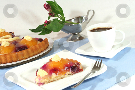 A piece of fruit cake with a cup of coffee stock photo, A piece of fruit cake with a cup of coffee and Alstroemeria by Marén Wischnewski