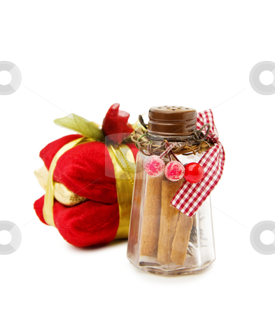 Christmas cinnamon jar stock photo, Celebrating Christmas with festive cinnamon jar and gifts. Isolated on white background. by Andreea Chiper