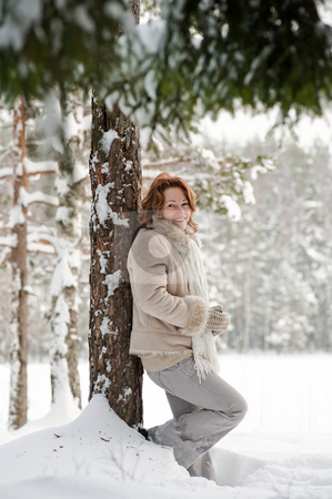 Woman in forest stock photo, Happy red-haired woman having fun on winters day in forest. by Roberts Ratuts