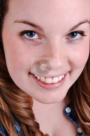 Face shoot of young girl. stock photo, A pretty face with blue eyes and blond hair in closeup, smiling into the camera. by Horst Petzold