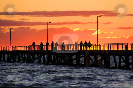 People on Jetty watching Sunset.  Semaphore Beach, Adelaide, Aus stock photo, People on Jetty watching Sunset.  Semaphore Beach, Adelaide, Australia. by Cloudia Newland