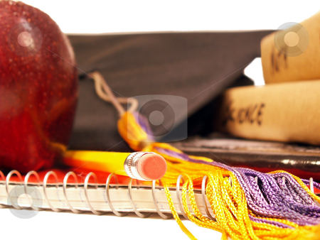 School's out stock photo, An apple, textbooks and a graduation cap on a notebook isolated on white by Christy Thompson