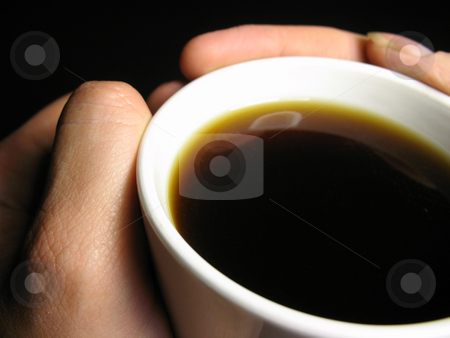 Morning coffee stock photo, Cup of coffee with hands wrapped around it. by Christy Thompson