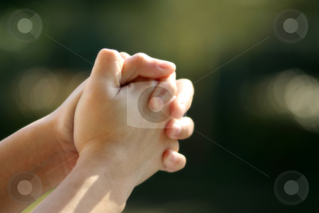 Pray stock photo, Praying (soft focus) by Suprijono Suharjoto
