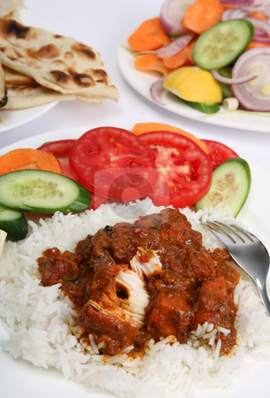 Chicken tikka masala meal vertical stock photo, A meal of chicken tikka masala with rice, salad and naan bread by Paul Cowan