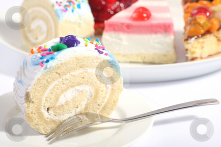 Sponge roll and plate of cakes