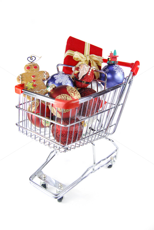 Christmas shopping for fun stock photo, Red present and ornaments in a shopping cart by Christy Thompson