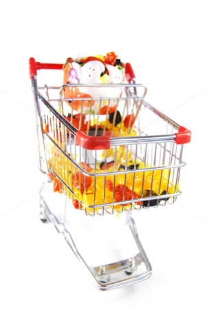 Shooping for halloween stock photo, Orange, black, and yellow candy with a haloween decoration in a shopping cart. Focus on front of cart. by Christy Thompson
