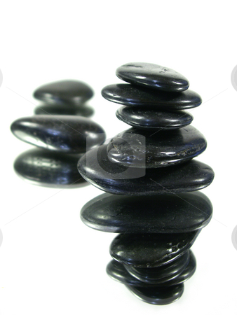 Reflected harmony stock photo, Rocks carefully stacked on a mirror isolated on white with others out of focus in the back. shallow depth of field. focus on front pile of rocks. by Christy Thompson