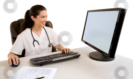Nurse Sitting and Working at her Computer stock photo, A nurse is sitting and worrking at her computer. by Denis Pepin