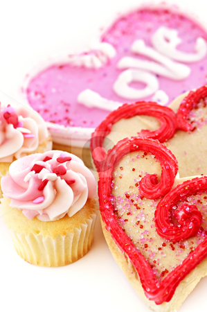Valentines cookies stock photo, Homemade baked shortbread Valentine cookies and cupcakes with icing on white background by Elena Elisseeva