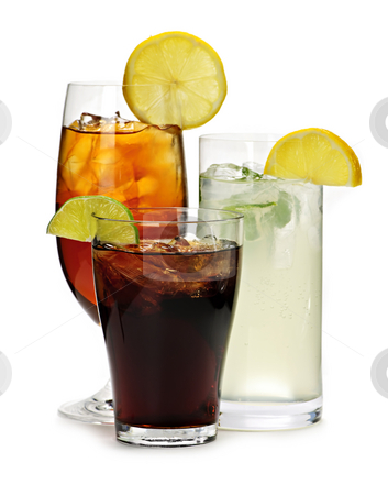Soft drinks stock photo, Group of three soft drinks in various glasses with garnish by Elena Elisseeva