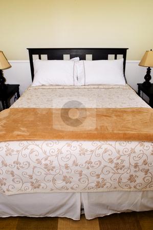 Bedroom stock photo, Bedroom interior with comfortable queen size bed by Elena Elisseeva