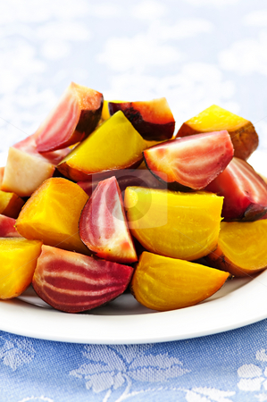 Roasted red and golden beets stock photo, Closeup of roasted sliced red and golden beets on a plate by Elena Elisseeva