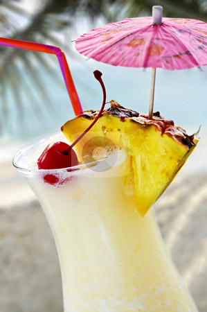 Pina colada stock photo, Pina colada tropical drink at sandy beach on the ocean by Elena Elisseeva