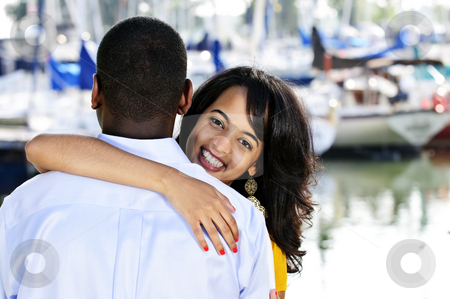 Happy woman hugging man stock photo, Beautiful young woman hugging boyfriend standing at harbor by Elena Elisseeva