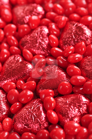 Valentine candy stock photo, Background of red Valentine's candies and foil wrapped chocolates by Elena Elisseeva