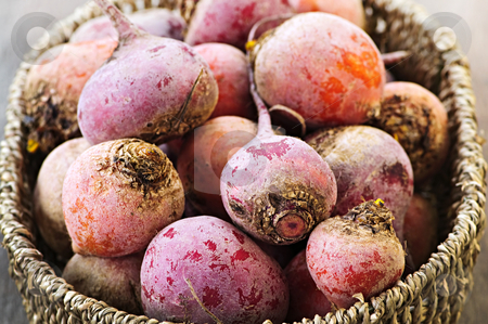Red and golden beets stock photo, Close up on basket of many whole red and golden beets by Elena Elisseeva