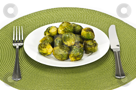 Plate of brussels sprouts stock photo, Plate of green brussels sprouts with knife and fork by Elena Elisseeva